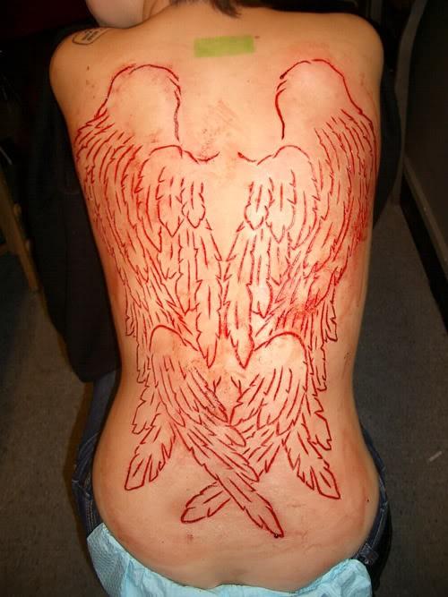 Big skin scarification wings on back for girls
