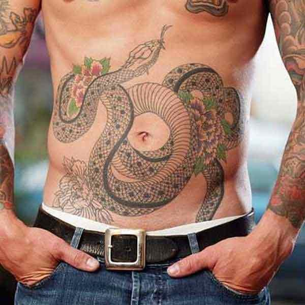 Black and gray snake with flowers tattoo on belly