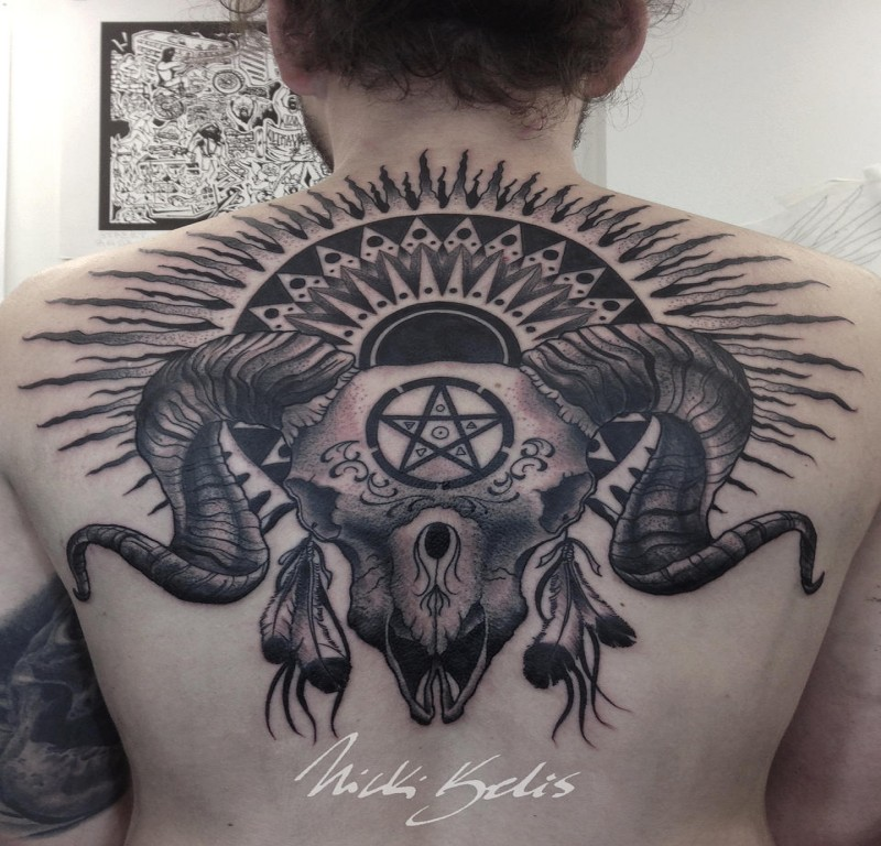 Black and gray style detailed upper back tattoo of cool demonic skull with sun and symbols