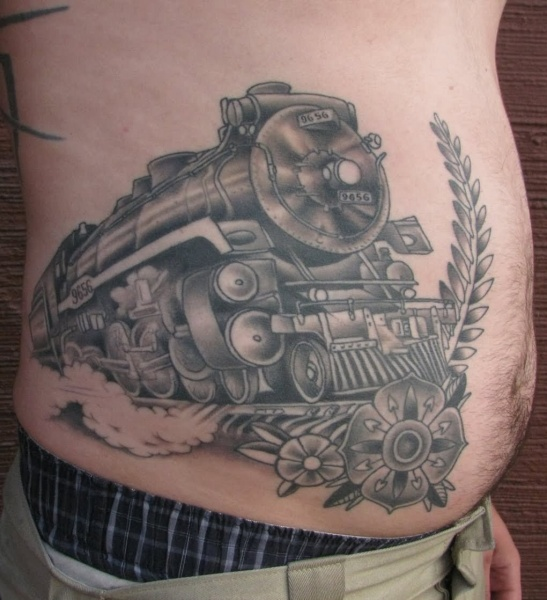Black and gray style large belly tattoo of steam train with flowers