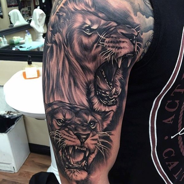 Black and gray style shoulder tattoo of lion heads family
