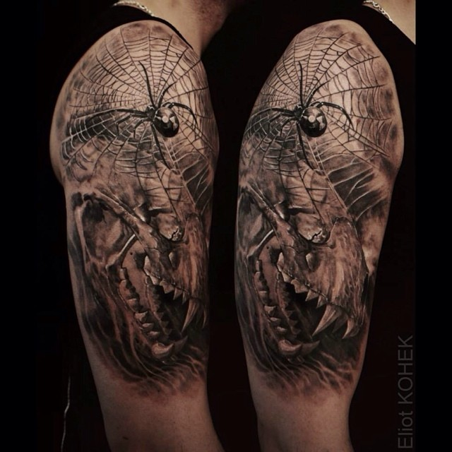 Black and gray style very detailed shoulder tattoo of incredible spider with skull
