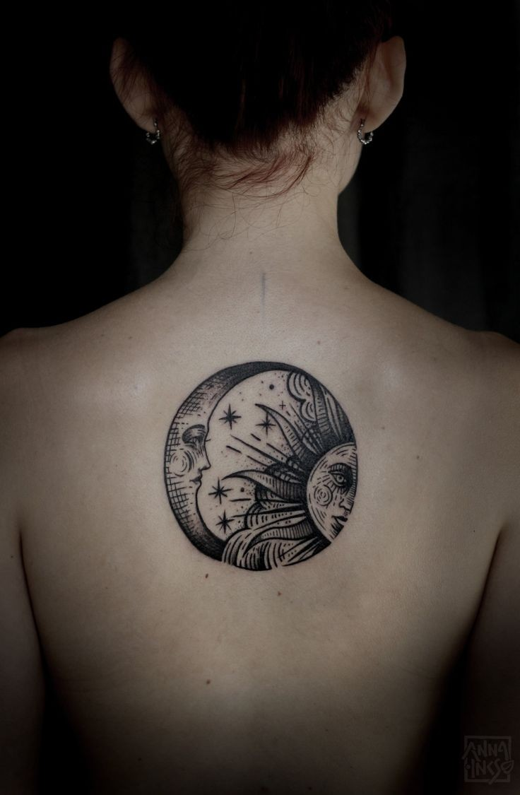 Black gray sun and Moon tattoo on back