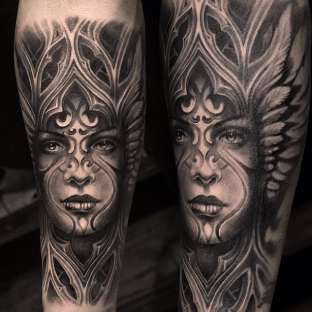 Black ink arm tattoo of tribal woman with ornaments