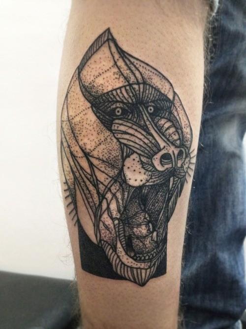 Black ink baboon head tattoo