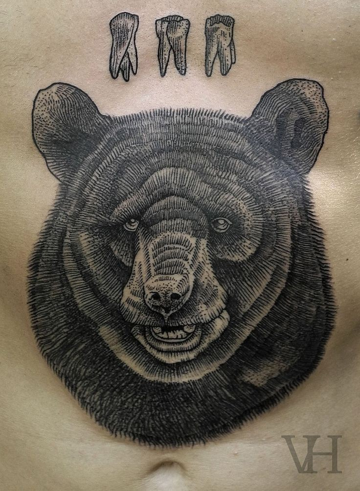 Black ink bear and bear teeth tattoo on stomach