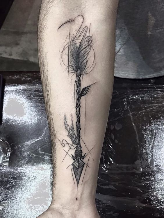 Black ink creative looking forearm tattoo of ancient arrow