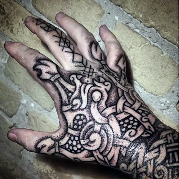 Black ink detailed hand tattoo of Celtic ornament