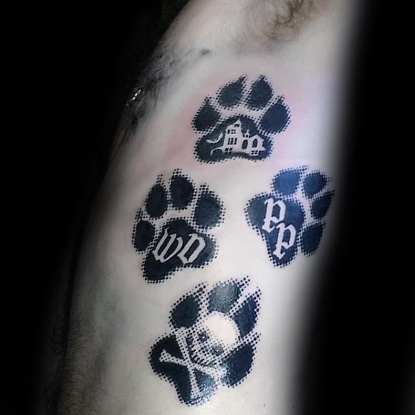 Black ink modern style side tattoo of big dog paw prints stylized with various symbols