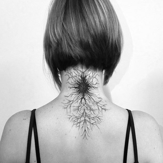 Black ink original designed neck tattoo of cool ornaments