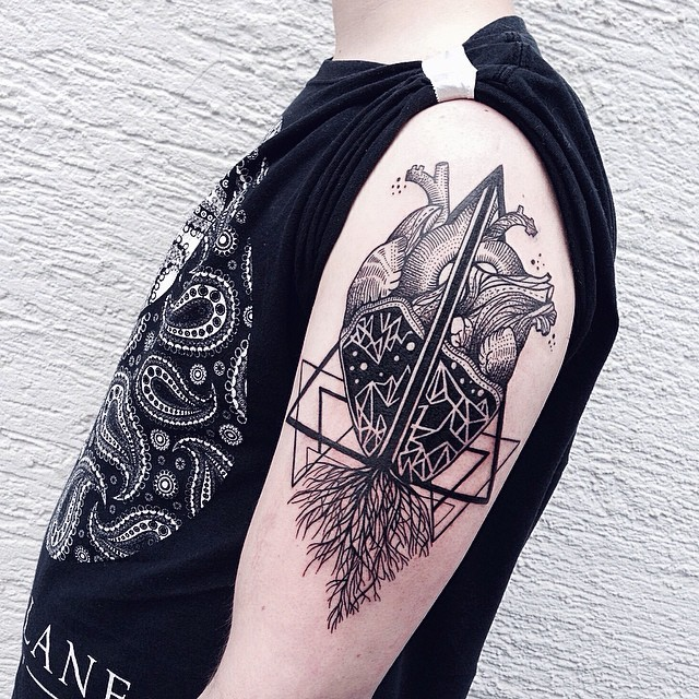 Black ink original designed shoulder tattoo of human heart with ornaments