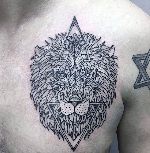 Black ink simple looking chest tattoo of lion head with triangles