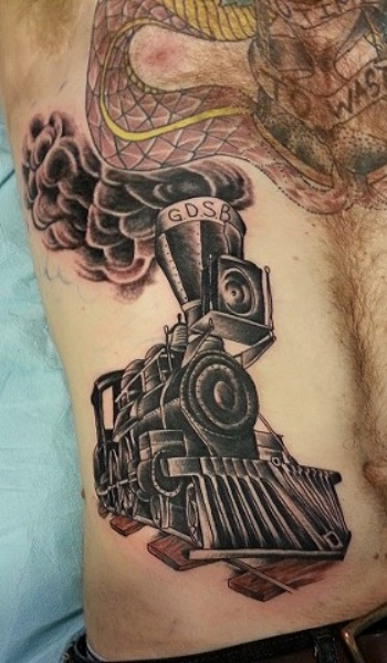 Black ink train tattoo painted in old school style on belly
