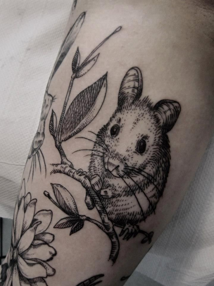 Black realistic rodent tattoo on arm