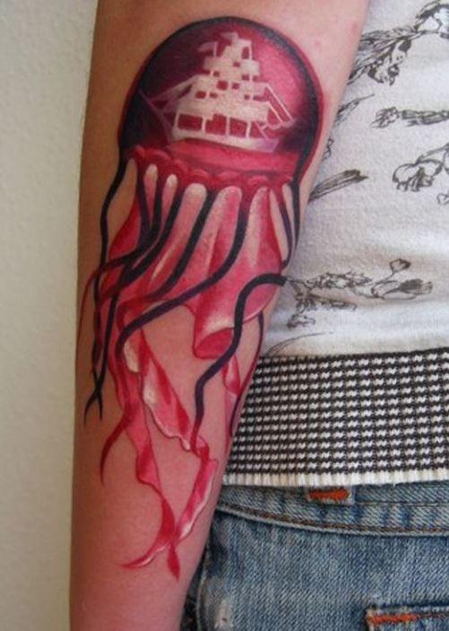 Black red jellyfish forearm tattoo