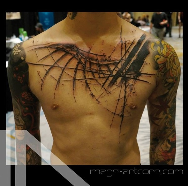 Blackwork style black ink chest tattoo of bird wing