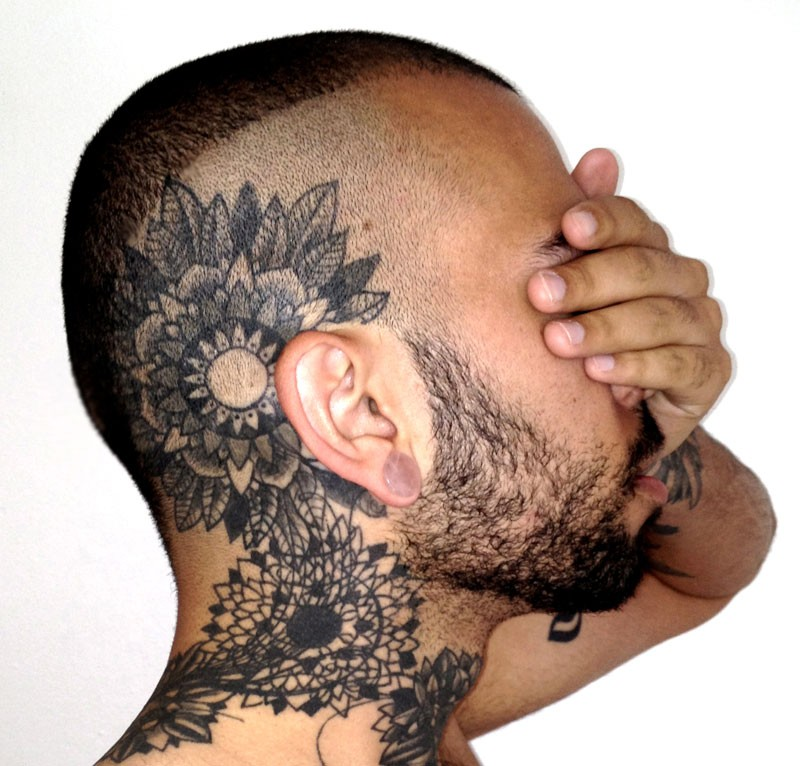 Blackwork style large head and neck tattoo of various flowers