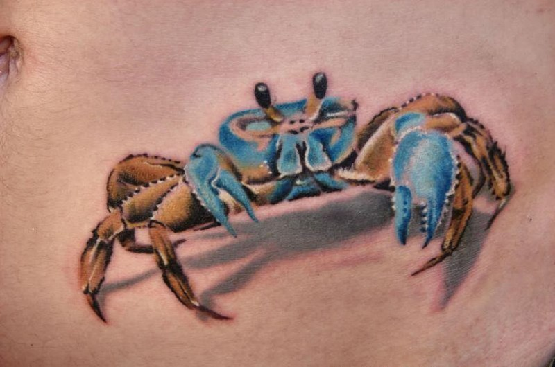 Blue 3d crab tattoo on belly