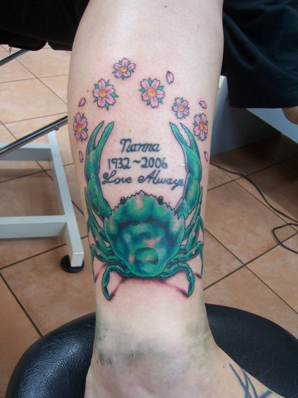 Blue crab tattoo with flowers and lettering