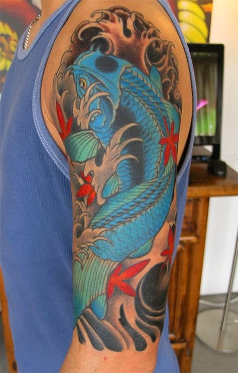 Blue koi fish tattoo on arm