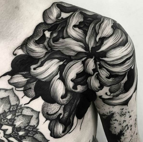 Breathtaking very beautiful shoulder tattoo of large flower