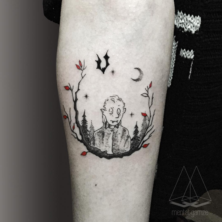 Cartoon style colored arm tattoo of funny looking vampire with moon and bat
