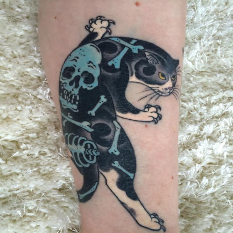 Cartoon style colored leg tattoo of Manmon cat with human skeleton