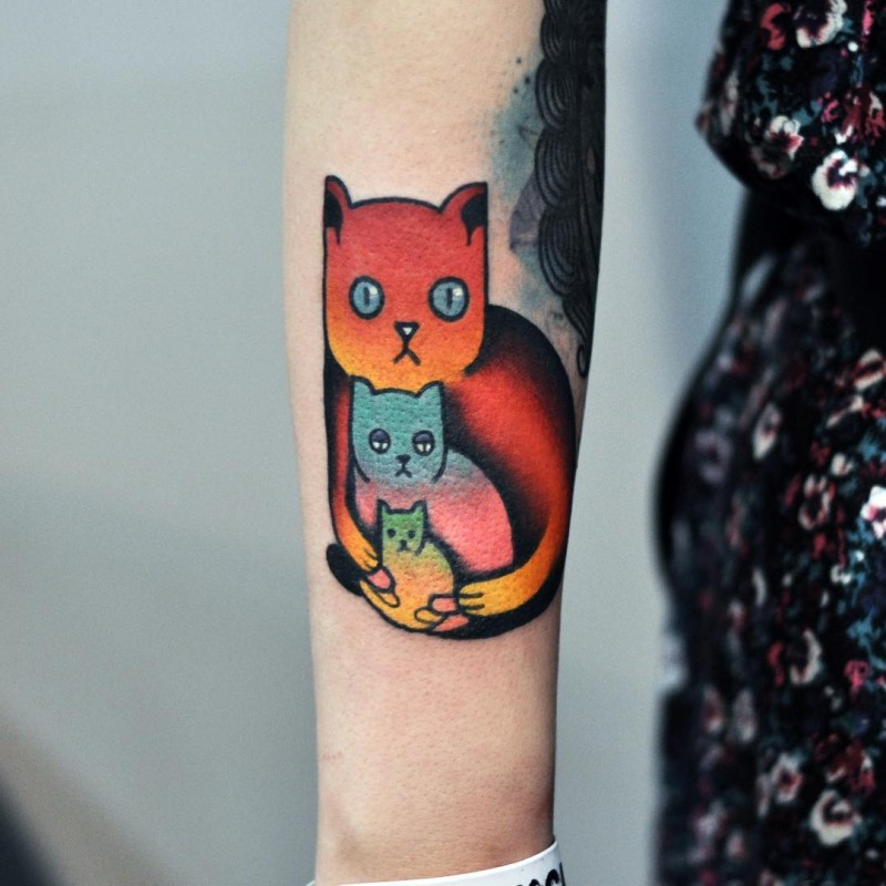 Cartoon style colored leg tattoo painted by David Cote of cats family