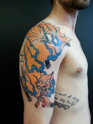 Cartoon style colored shoulder tattoo of big dragon