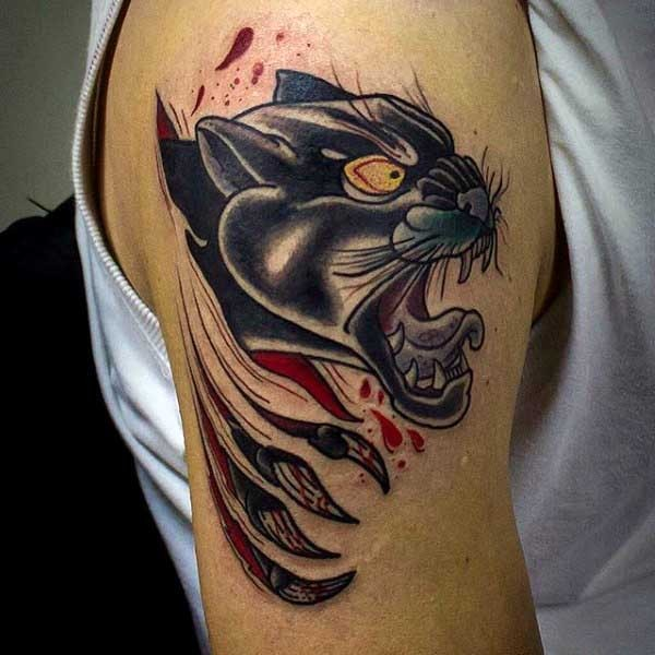 Cartoon style colored shoulder tattoo of black panther