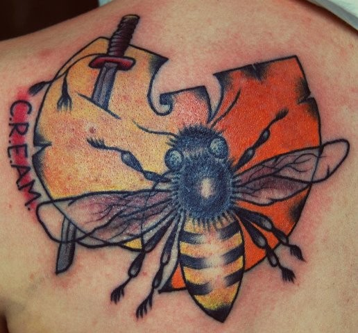 Cartoon style colored upper back tattoo of bee with interesting symbol, sword and lettering