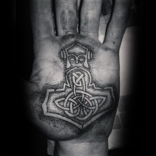 Celtic style black ink hand tattoo of ancient symbol