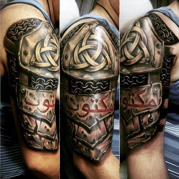 Celtic style colored shoulder tattoo of armor with emblems