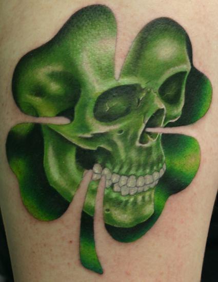 Skull in green four leaf clover tattoo