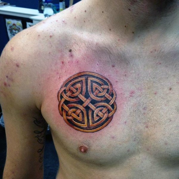 Colored funny looking chest tattoo of of Celtic symbol
