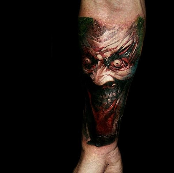 Colored horror style creepy looking forearm tattoo of colored demon
