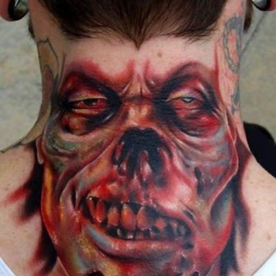 Colored horror style creepy looking neck tattoo of monster face