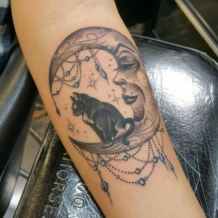 Colored interesting style colored forearm tattoo of moon with jewelry and cat