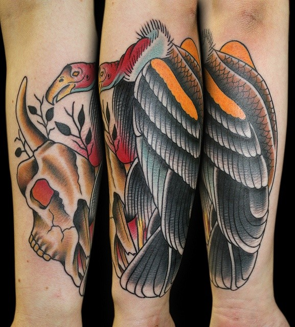 Colored old school style forearm tattoo of large animal skull with bird