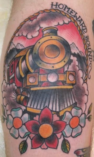 Colored portrait style leg tattoo of steam train with lettering and flower
