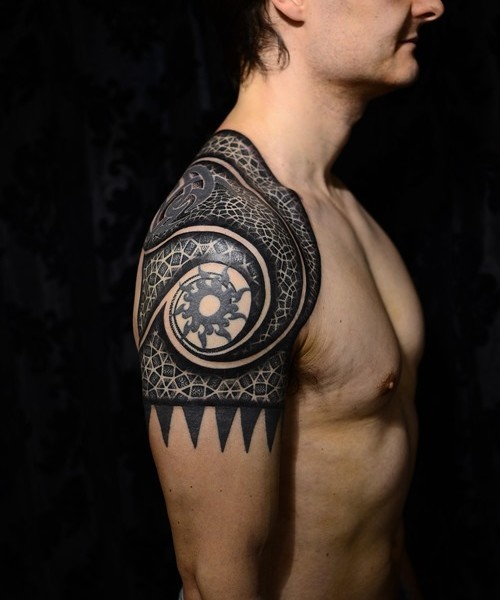 Colored shoulder tattoo of various Celtic ornaments