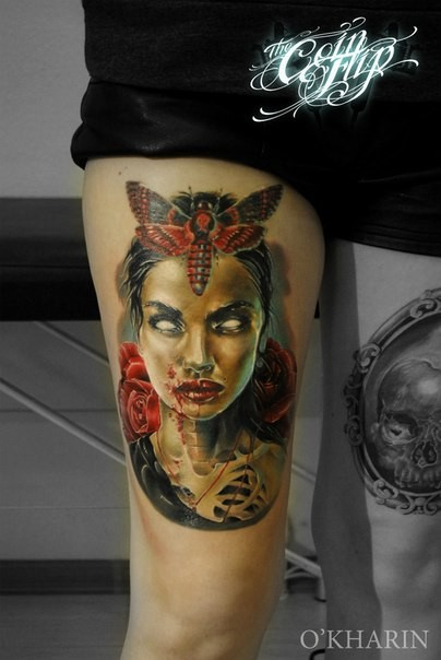 Colored very detailed thigh tattoo of bloody woman with butterfly