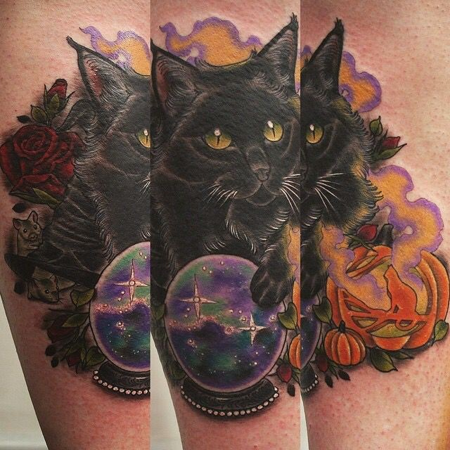 Colorful beautiful looking leg tattoo of dark cat and magical orb