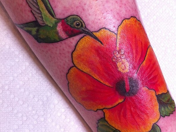 Colorful hummingbird and hibiscus tattoo