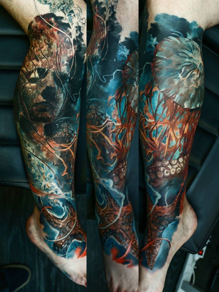 Colorful illustrative style leg tattoo of sunken statue with octopus and jellyfish