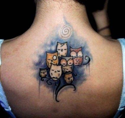Colorful illustrative style upper back tattoo of cute owl on tree