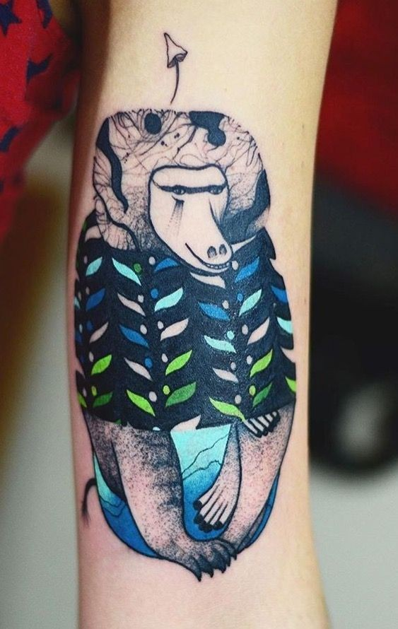 Colorful psychedelic looking arm tattoo of funny monkey
