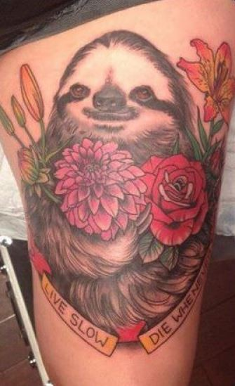 Coloured sloth with flowers and quote tattoo on hip