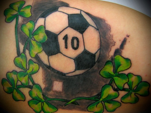 Coloured soccer ball with green clover tattoo