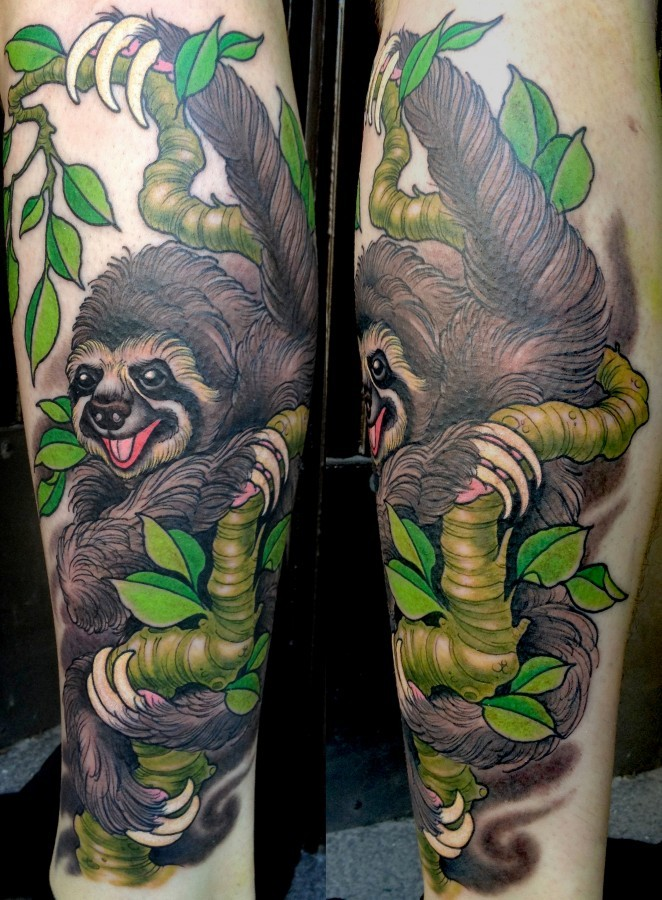 Colourful sloth on tree tattoo